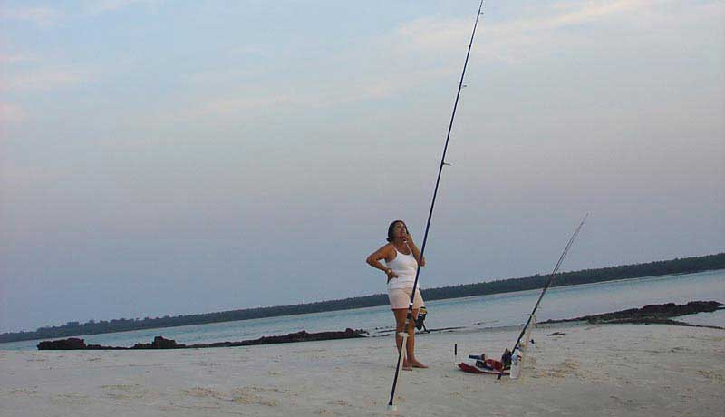 fisherman who is waiting during surfcasting on kere bijagos